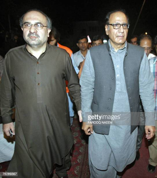 Pakistani Information Minister Mohammad Ali Durrani and former premier Chaudhry Shujaat Hussain arrive after holding talks with redical cleric Abdul...