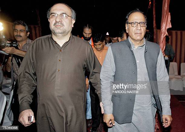 Pakistani Information Minister Mohammad Ali Durrani and former premier Chaudhry Shujaat Hussain arrive after holding talks with radical cleric Abdul...