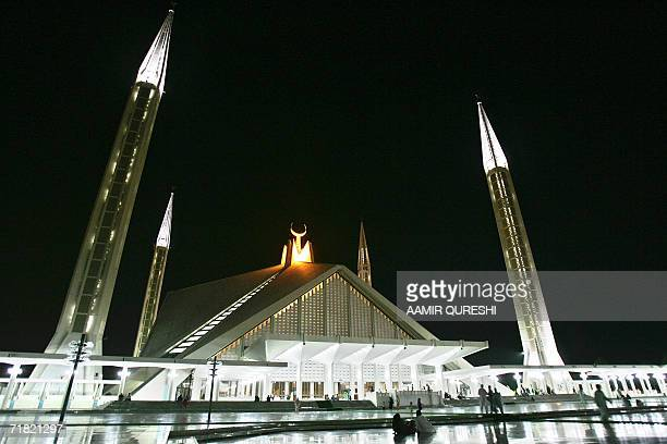 Pakistani Muslim devotees arrive to pray during a special night prayer at The Faisal Mosque in Islamabad 08 September 2006 to mark ShabeBarat Many...