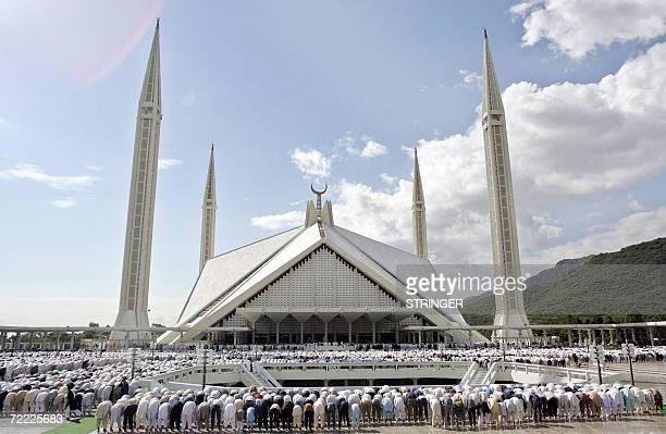 Pakistani Muslims participate in the last Friday noon prayers of the Holy month of Ramadan at the Faisal Mosque in Islamabad 20 October 2006 Tens of...