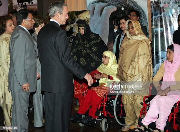 Pakistani President Pervez Musharraf and his wife Sehba Musharraf look on as US President George W Bush speaks with Pakistani 0 earthquake survivors...