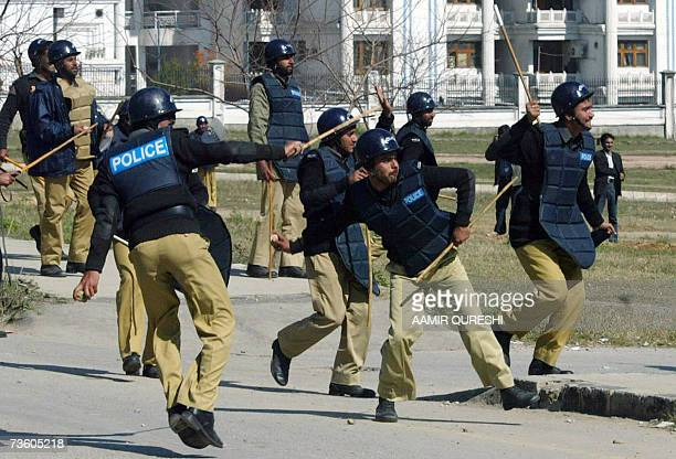 Pakistani riot police throw stones towards unsee protesters during a demonstration against the sacking of Chief Justice Iftikhar Muhammad Chaudhry in...