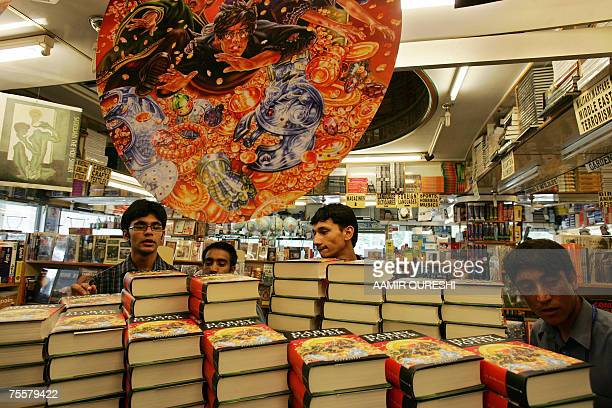 Pakistani youths look at Harry Potter books shortly before the release of Harry Potter and the Deathly Hallows at a bookstore in Islamabad 21 July...