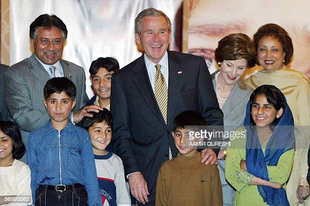 Pakistan's President Pervez Musharraf US President George W Bush US First Lady Laura and Pakistani First Lady Sehba Musharraf pose with children left...
