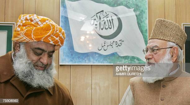 Qazi Hussain Ahmad chief of Pakistan's hardline Muttahida MajliseAmal and opposition leader Maulana Fazlur Rehman arrive at their supreme council...