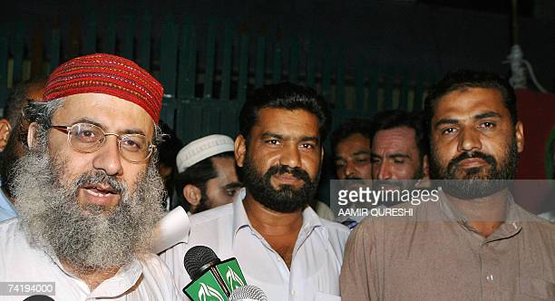 The deputy leader of Red Mosque Abdul Rashid Ghazi speaks to the media along with the released Pakistani policemen in front of the mosque in...