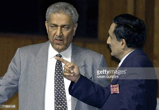 This picture taken 06 January 2004 shows the father of Pakistan's nuclear bomb Abdul Qadeer Khan talking to an unidentified official during the...