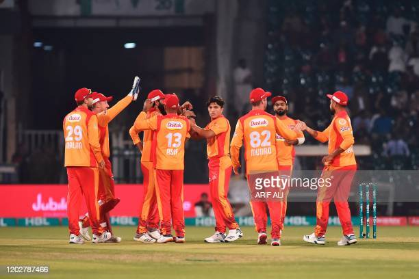 Islamabad United celebrate the wicket of Lahore Qalandars Chris Lynn during the Pakistan Super League T20 cricket match between Islamabad United and...
