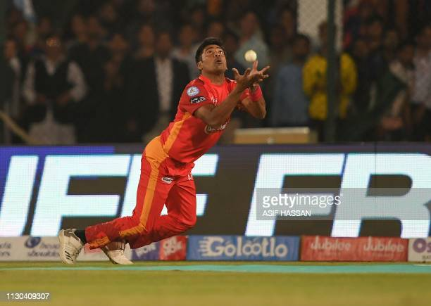 Islamabad United cricket captain Mohammad Sami takes a catch during the elimination match between the Islamabad United and Karachi Kings of the...