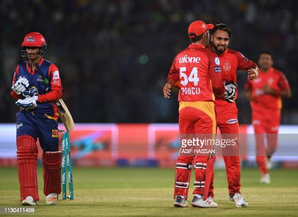 Islamabad United cricketer Faheem Ashraf celebrates with teammates after taking the wicket of Umar Khan of Karachi Kings during the elimination match...