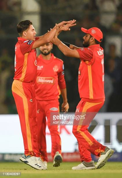 Islamabad United cricketer Muhammad Musa celebrates with teammates after taking the wicket during the elimination match between the Islamabad United...