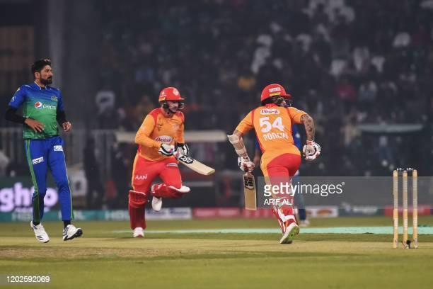 Islamabad United Luke Ronchi and Colin Munro take a run while Multan Sultans Sohail Tanvir looks the ball during the Pakistan Super League T20...