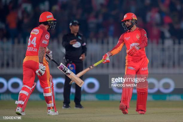 Islamabad United Luke Ronchi and Shadab Khan celebrate the four runs during the Pakistan Super League T20 cricket match between Islamabad United and...