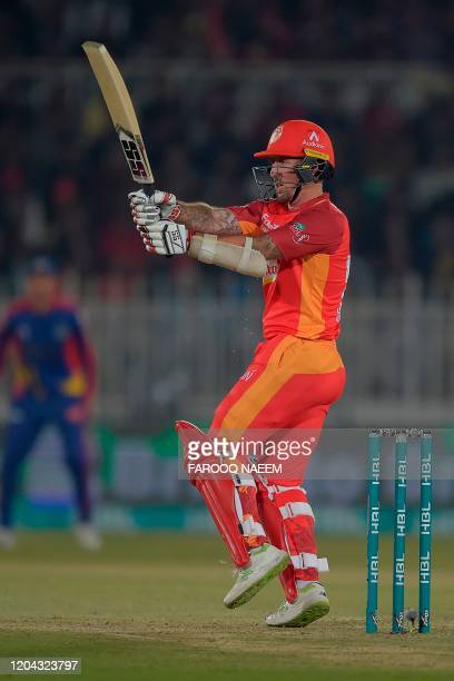 Islamabad United Luke Ronchi hits a six off the bowling during the Pakistan Super League T20 cricket match between Islamabad United and Karachi Kings...