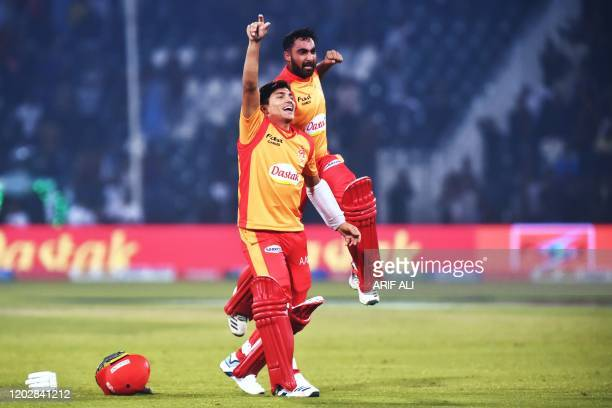 Islamabad United Muhammad Musa and Ahmed Safi Abdullah celebrate a victory against Lahore Qalandars during the Pakistan Super League T20 cricket...