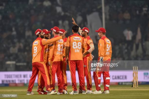Islamabad United's cricketers celebrate the dismissal of Multan Sultans' Zeeshan Ashraf during the Pakistan Super League T20 cricket match...