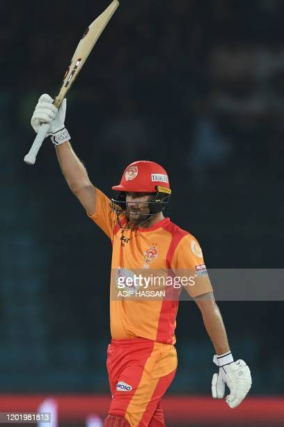 Islamabad United's Dawid Malan celebrates after scoring half century during the Pakistan Super League Twenty20 cricket match between Quetta...