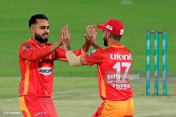 Islamabad United's Faheem Ashraf celebrateswith teammate the wicket ofMultan Sultan'sChris Lynn during the Pakistan Super League T20 cricket match...