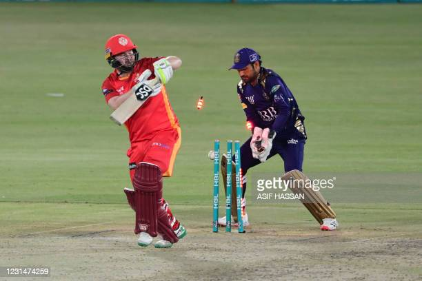 Islamabad United's Paul Stirling is bolwedQuetta Gladiators' Zahid Mahmood during the Pakistan Super League T20 cricket match between Islamabad...