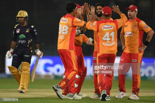 Islamabad United's players celebrate after the dismissal of Quetta Gladiators's Sarfraz Ahmed during the Pakistan Super League Twenty20 cricket match...