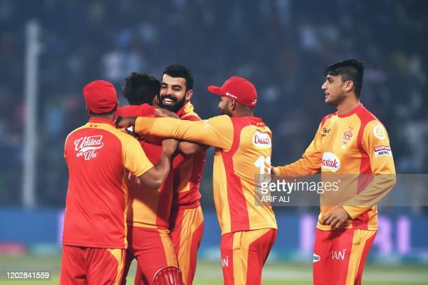 Islamabad United's players celebrate victory against Lahore Qalandars during the Pakistan Super League T20 cricket match between Islamabad United and...
