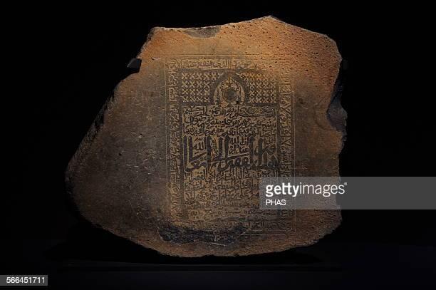 Islamic art Tombstone of Shaykh 'Afif Allah son of 'Abdallah son of 'Ali son of Sulayman son of 'Arafa alMakki 767H /13656 AD Basalt 50x57x22 cm...