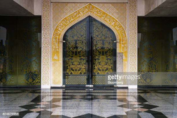 Islamic artwork is seen on the walls and a doorway at the Crystal Mosque in Kuala Terengganu Terengganu Malaysia on Monday July 23 2017 With a...