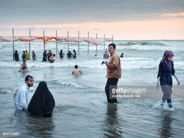 islamic beach life, caspian sea, iran - muslim woman beach stock photos and pictures