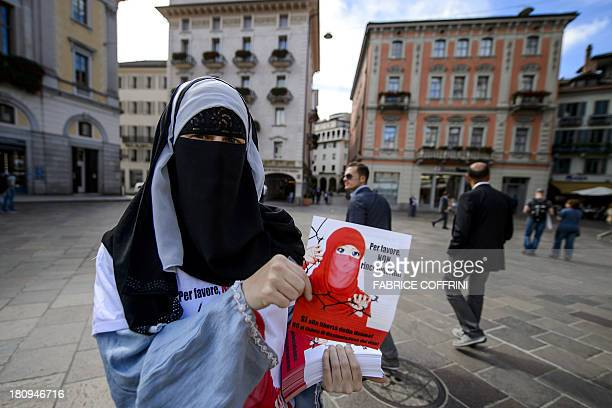 Islamic Central Council of Switzerland member Nora Illi one of the few Swiss women wearing the niqab poses on September 18 2013 while distributing...