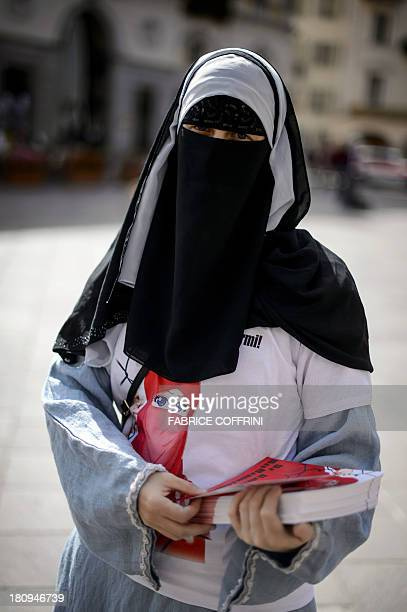 Islamic Central Council of Switzerland member Nora Illi one of the few Swiss women wearing the niqab distributes flyers reading Please don't lock me...