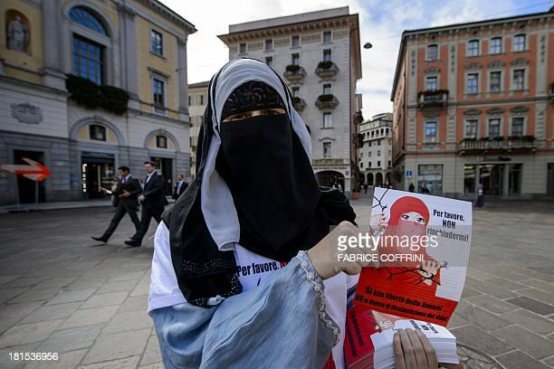 Islamic Central Council of Switzerland member Nora Illi one of the few Swiss women wearing the niqab distributes flyers against a cantonal vote on...