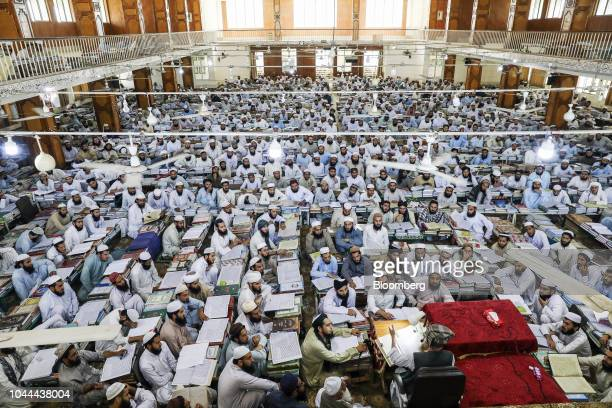 Islamic cleric Maulana Samiul Haq chancellor of Darul Uloom Haqqania madrassa and former senator bottom right delivers a lecture to finalyear...