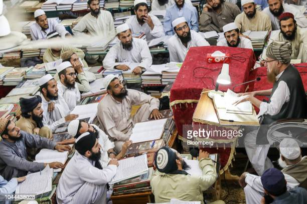 Islamic cleric Maulana Samiul Haq chancellor of Darul Uloom Haqqania madrassa and former senator right delivers a lecture to finalyear students at...