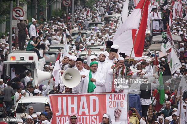 Islamic Defender Front and political leaders stand on Jihad constitution vehicle joined around thousand protester rally to Presidential Palace...