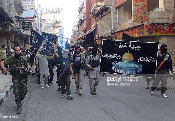 Islamic fighters from the alQaida group in the Levant AlNusra Front carry a movement's banner bearing a drawing of Jerusalem's Dome of the Rock...