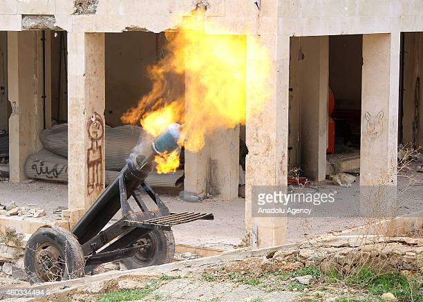 Islamic Front memners attack Assad regime forces with a handmade cannon in the alBureij area north of Aleppo Syria on December 10 2014