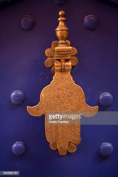 islamic hamsa as a door knocker, marrakech - hamsa symbol stock photos and pictures