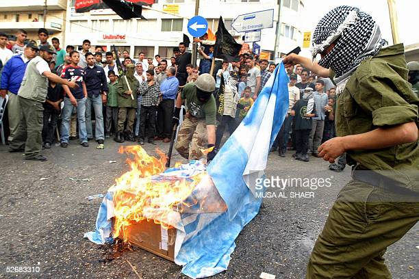 Islamic Jihad supporters burn an Israeli flag during a rally commemorating the third anniversary of the siege of the Church of the Nativity in the...