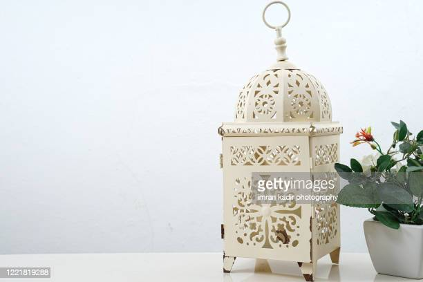 islamic lantern cover and flower pod on table with copy space - ramadan decoration stock pictures, royalty-free photos & images