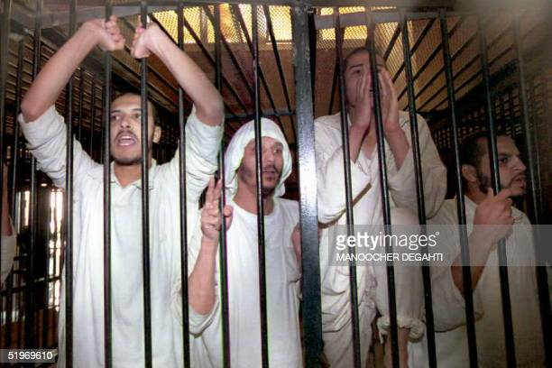 Islamic militants chant religious slogans 10 January from a jail cell in the military court in Haekstep Egypt north of Cairo after they were...