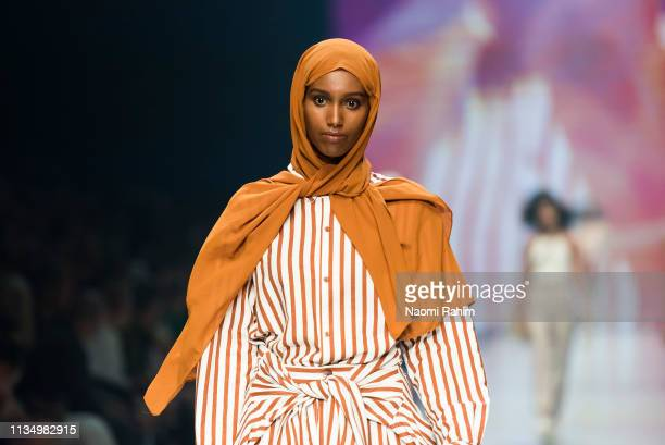Islamic model Hanan Ibrahim showcases designs by Client Liaison Deluxe Line wearing a hijab at Melbourne Fashion Festival on March 9 2019 in...