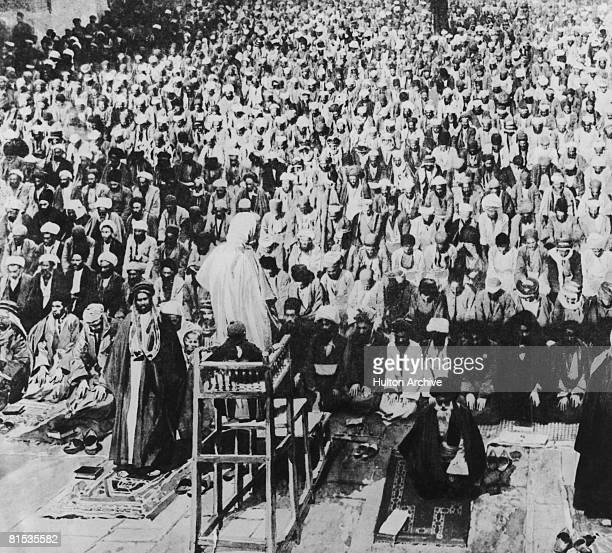 Islamic pilgrims at prayer at the Kaaba in Mecca 1908 Published in the French magazine 'L'Illustration'