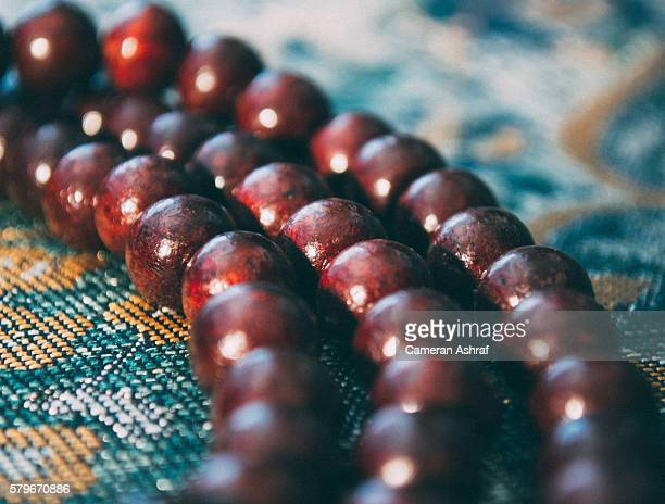 Islamic Prayer Beads on Prayer Mat