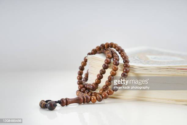 islamic prayer beads with staging book on table. copy space - religious celebration stock pictures, royalty-free photos & images