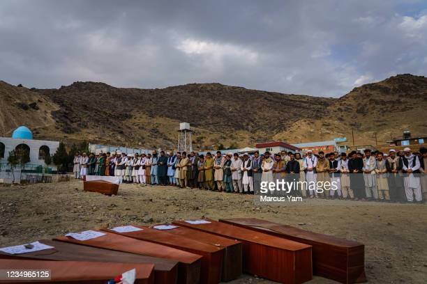 Islamic prayers are recited for the bodies before they could be laid into the ground to be buried, as around 200 people attend a mass funeral for the...