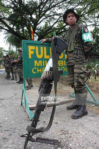 Islamic rebels of the Moro Islamic Liberation Front are seen at the check point inside their camp on September 5, 2011 in the southern Philippine...