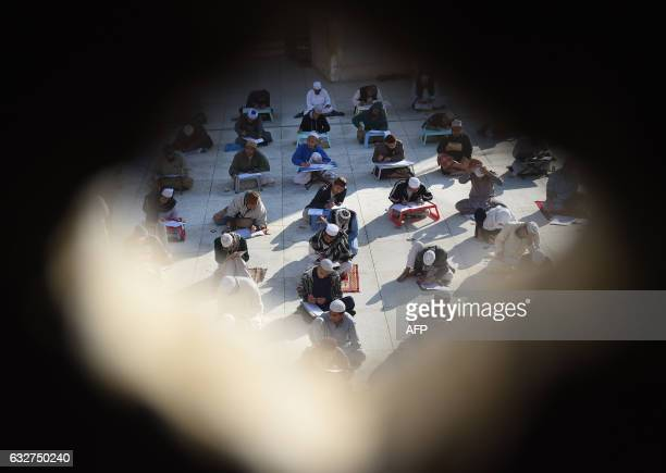 TOPSHOT Islamic religious students take midterm exams at Jamia Binoria the nation's largest Islamic seminary in Karachi on January 26 2017 Around...