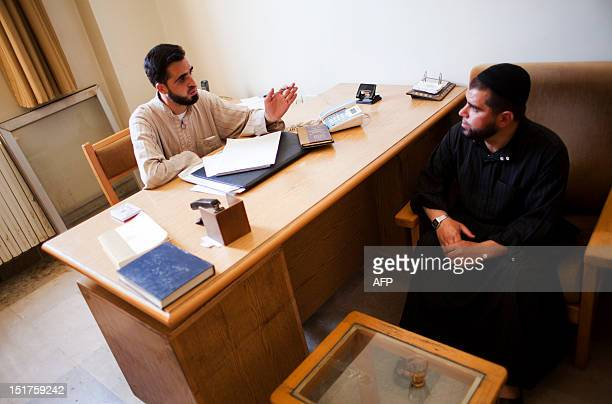 Islamic sharia law judge Mahmoud Aqeed listens to a complain by a civilian at a temporary Islamic court in the rebelcontrolled town of alBab 30...