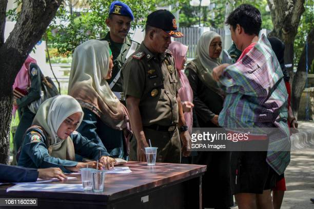 LHOKSEUMAWE ACEH INDONESIA Islamic Sharia Police Officers seen conducting data collection for those who violated Sharia law by force in the city of...