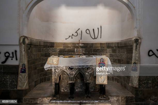 """Islamic State militants have written graffiti exclaming, """"God is Great"""" on the church alter of the Mar Behnam monastery on February 4, 2017 in Beth..."""